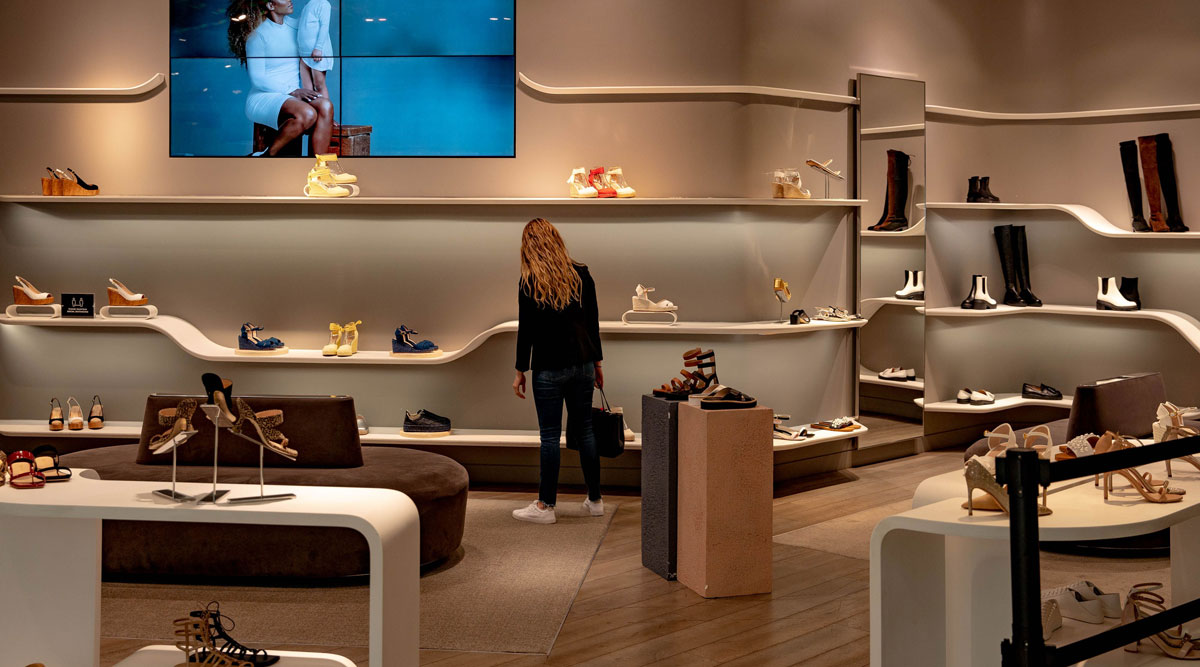 A shopper views shoes at a store in New York in May. (Amir Hamja/Bloomberg News)