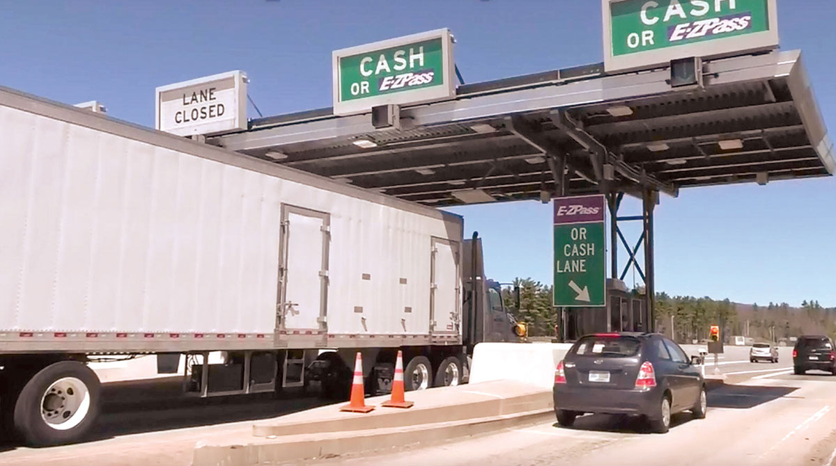 Truck going through tollbooth