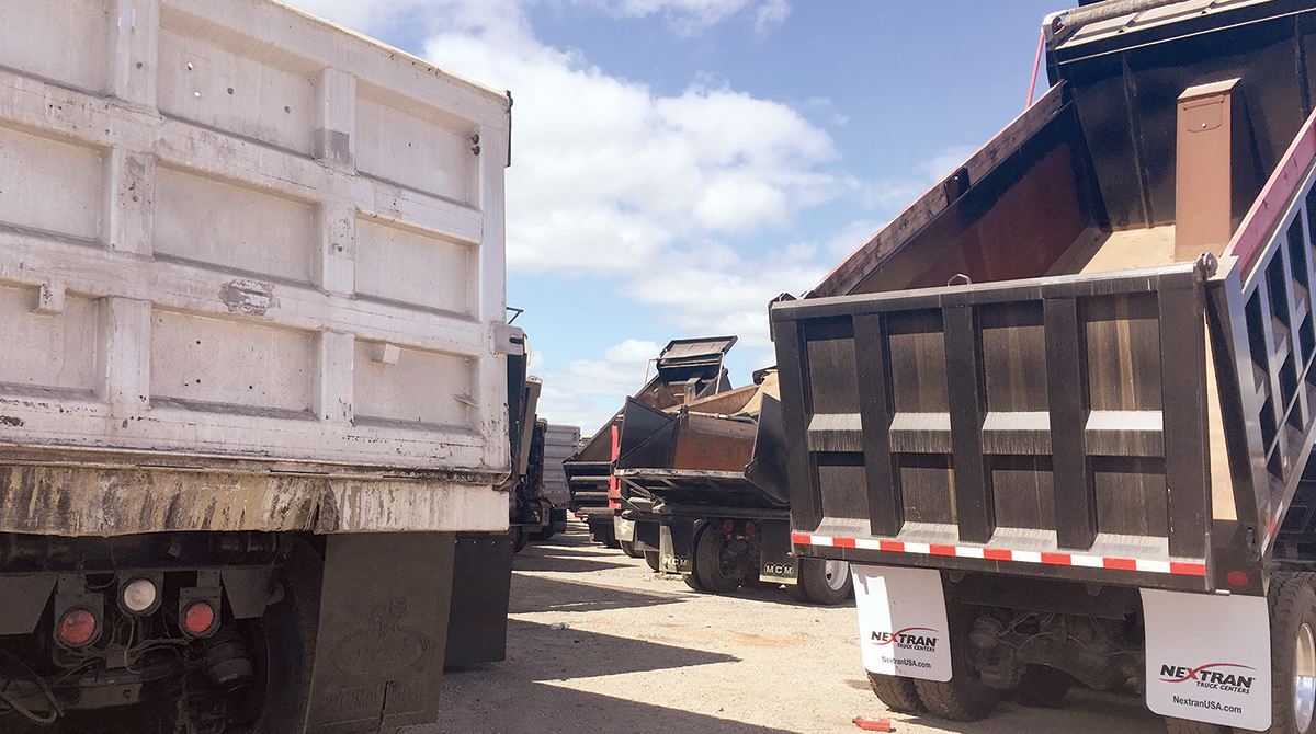 Dump trucks at Ritchie Bros. U.S. auction in Orlando, Fla.