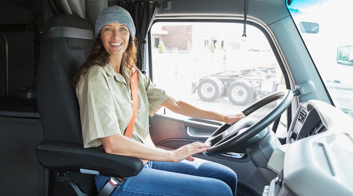 Female truck driver wearing a seat belt
