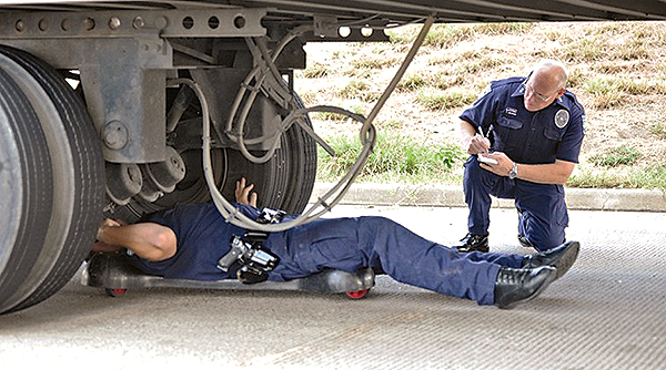 Officers perform a roadside inspection