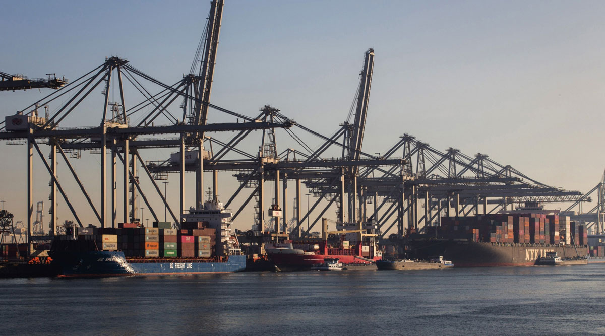 Container ships sit docked at the Port of Rotterdam on Sept. 21.
