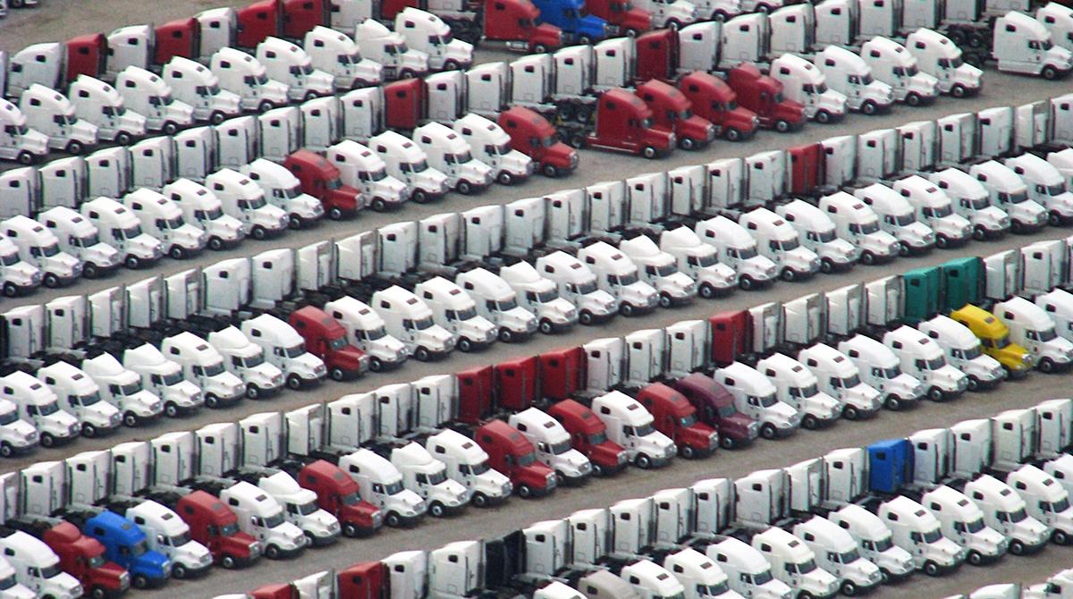 New Peterbilt trucks in a storage lot