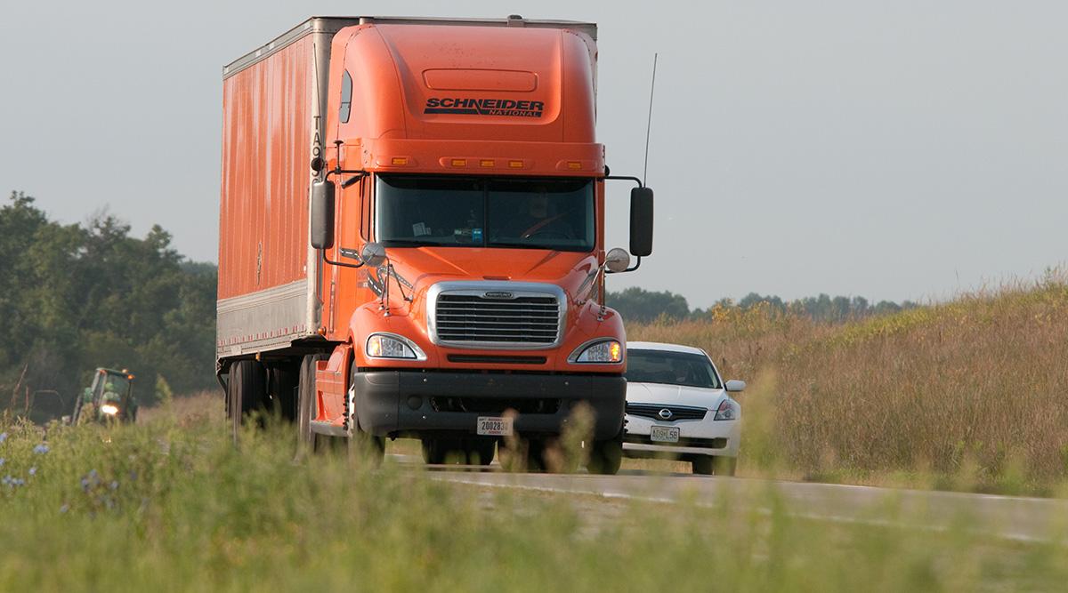 Schneider truck on a highway