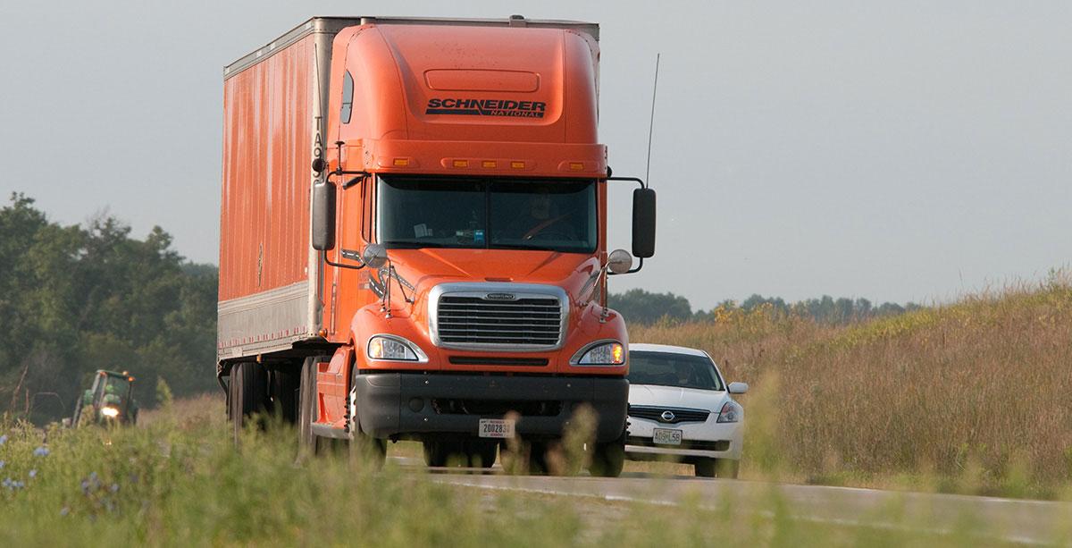 Schneider truck on a highway in Missouri