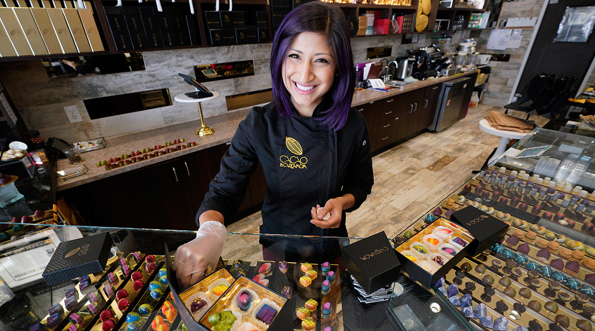 Businesswoman poses in her chocolate shop