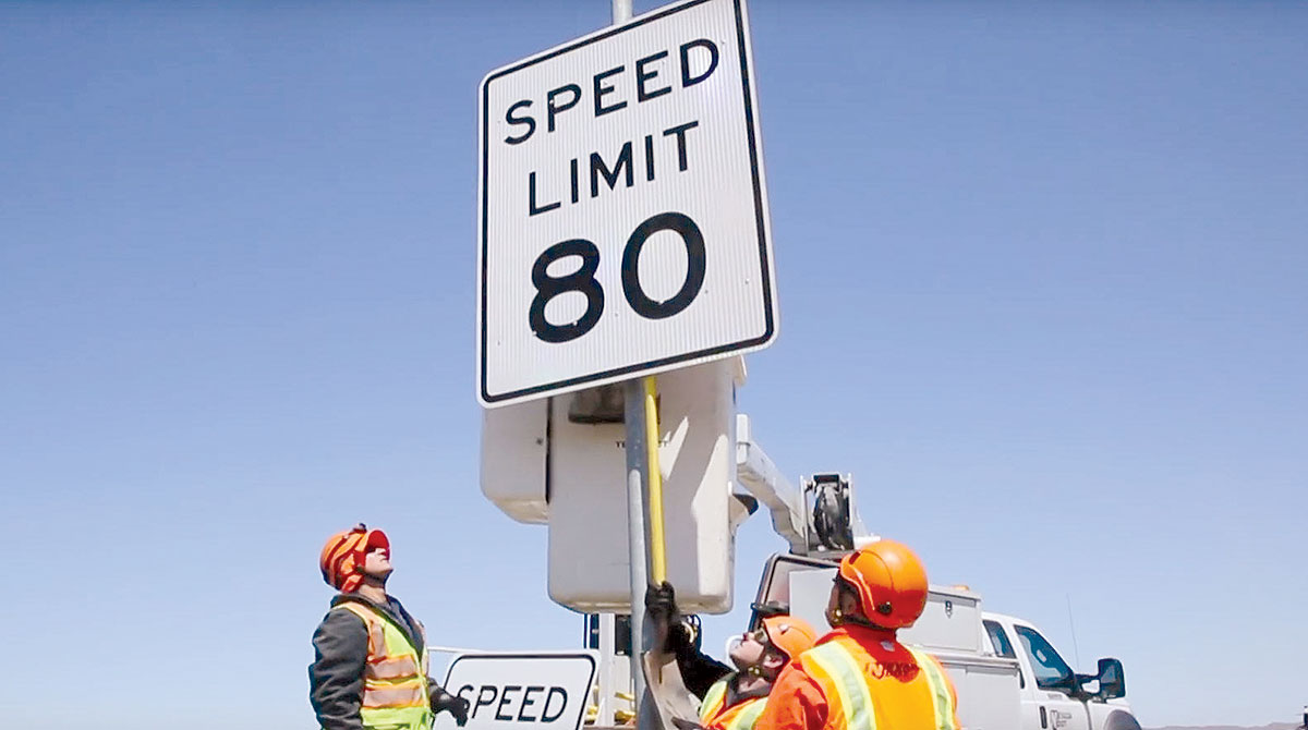 Workers install 80 mph speed limit sign in Nevada