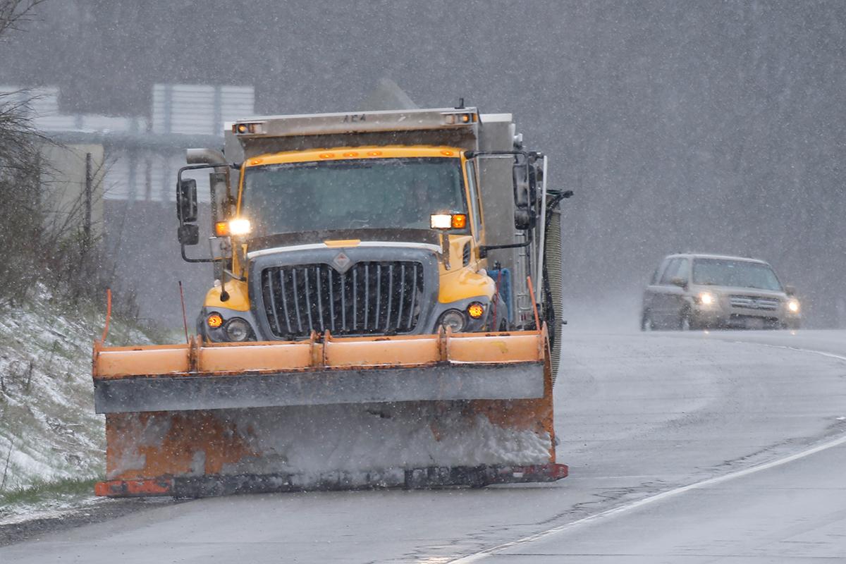 A snow plow works Interstate 79 in Zelienople, Pa.