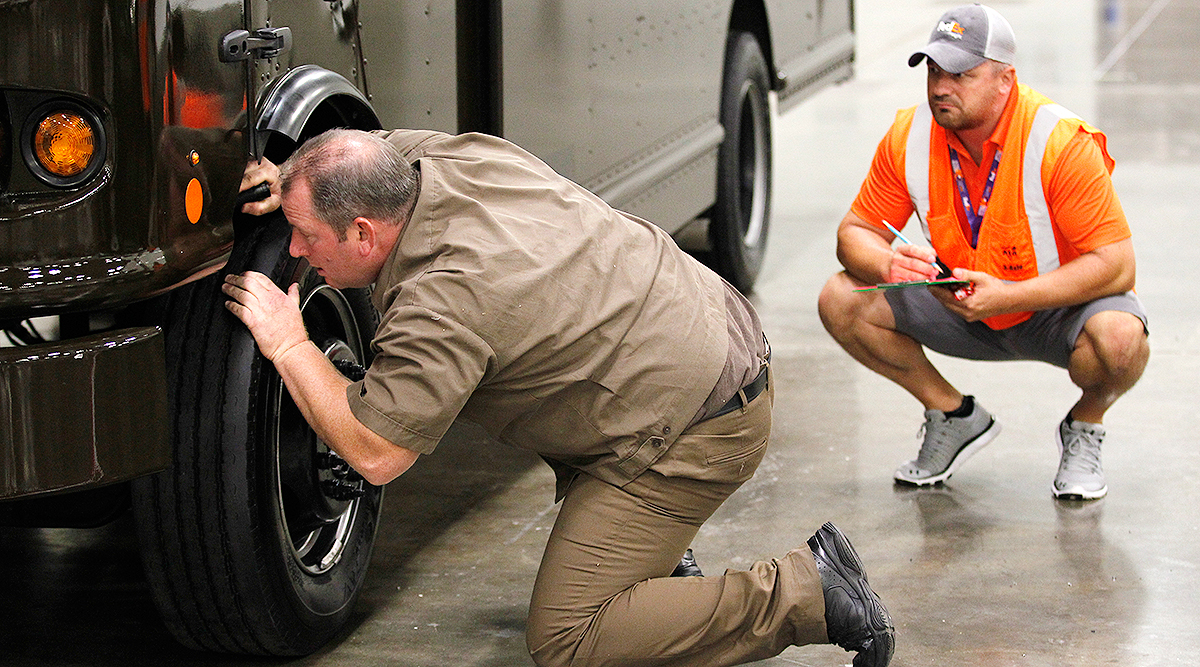 Driver inspects truck