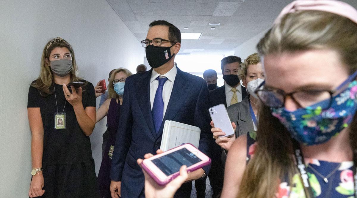 Steven Mnuchin, center, leaves a Senate Republican policy luncheon on Capitol Hill on July 21.
