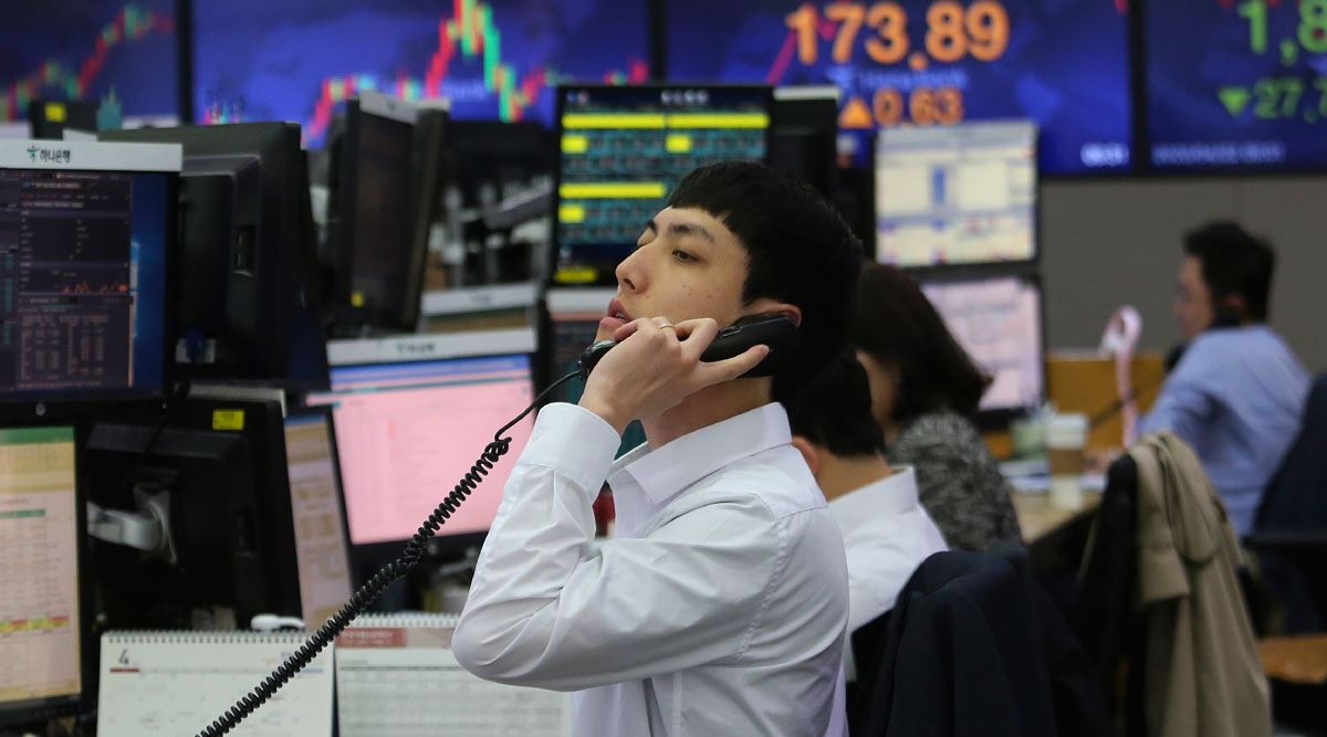 A currency trader talks on the phone at the foreign exchange dealing room of the KEB Hana Bank headquarters in Seoul, South Korea, on April 22.