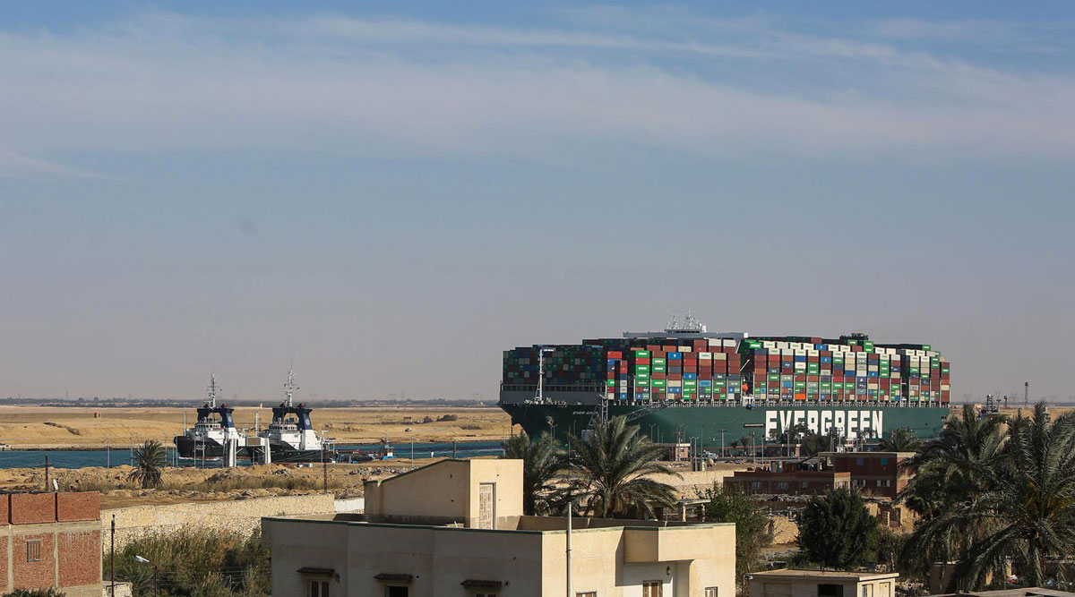 Tug boats pull the Ever Given containership along the Suez Canal on March 29.
