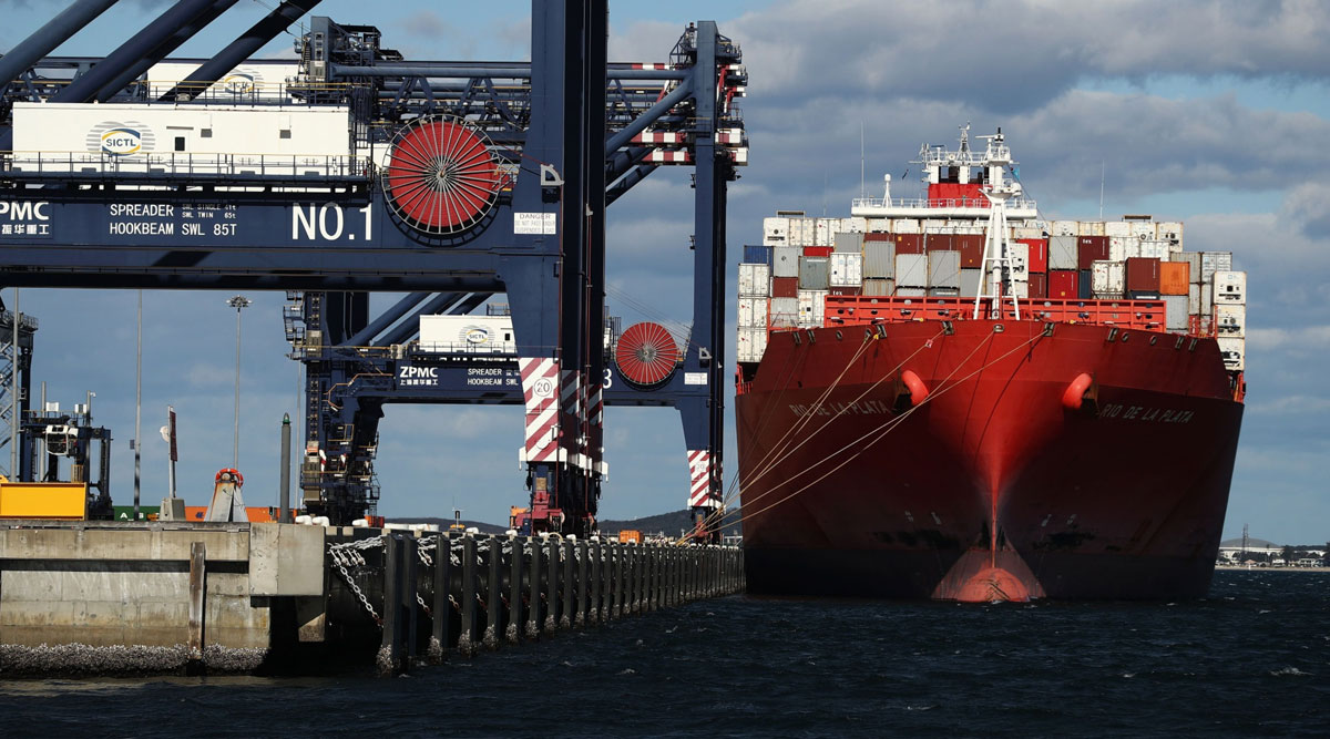 A container ship is docked at a terminal in Sydney, Australia, on June 3.
