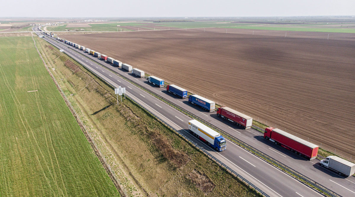 Trucks stand in a queue while waiting to cross the border from Hungary into Romania on April 8.