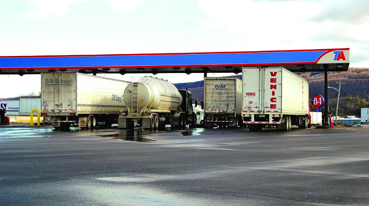 Trucks refuel at a TravelCenters of America stop