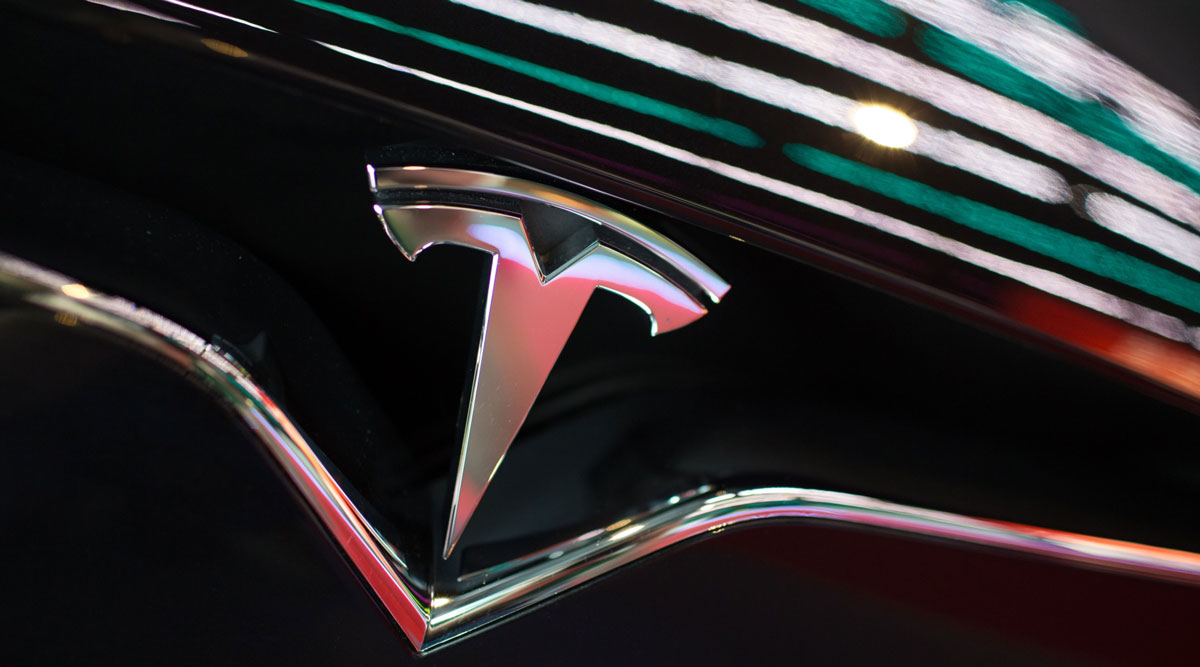 The Tesla logo is seen on the grille of a Model X vehicle in Moscow, Russia, in July 2018.