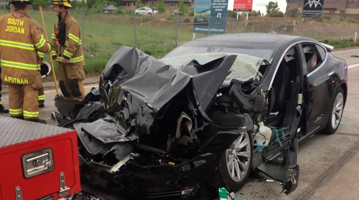 Damaged Tesla and firetruck
