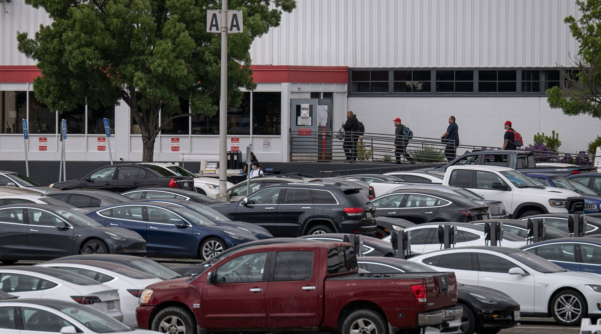 People enter the Tesla assembly plant in Fremont, Calif., on May 11.
