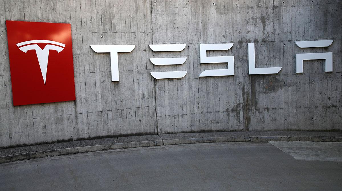 Tesla sign outside a dealership