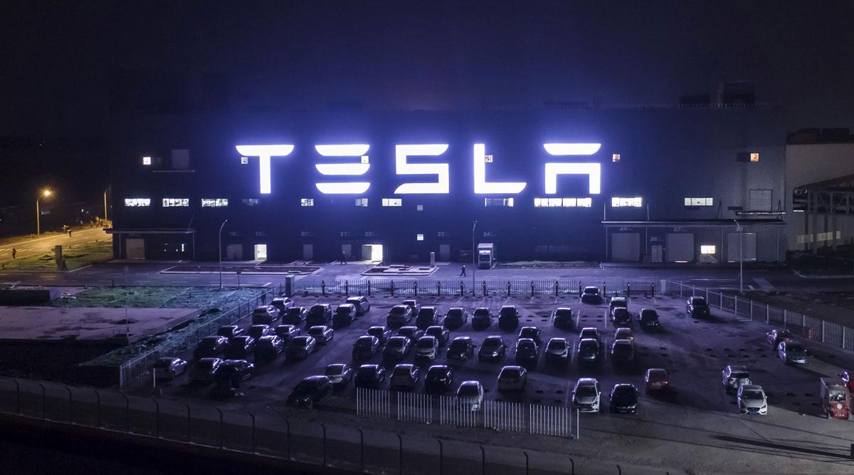 The Tesla Gigafactory in Shanghai, China, stands illuminated at night.