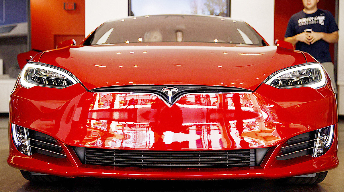 Tesla's stock jumps after report of investment interest by German automobile makers