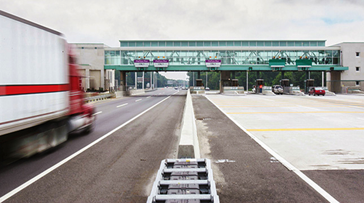 Truck approaches toll booth