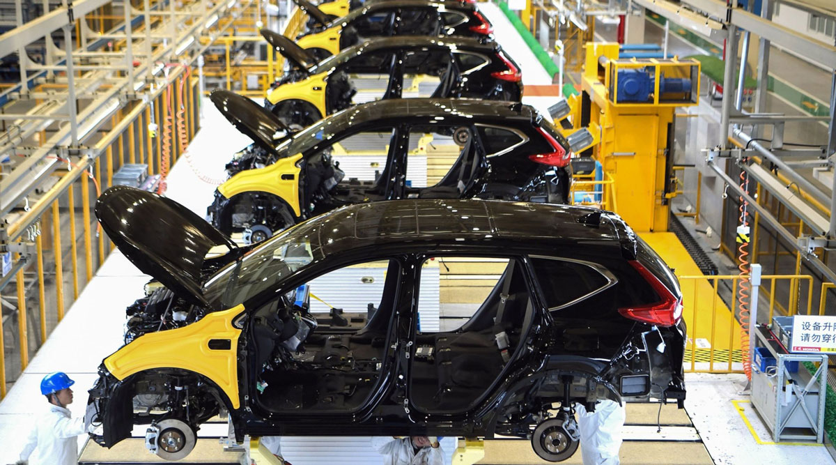 Employees work on a Honda auto plant assembly line in Wuhan in November 2019.