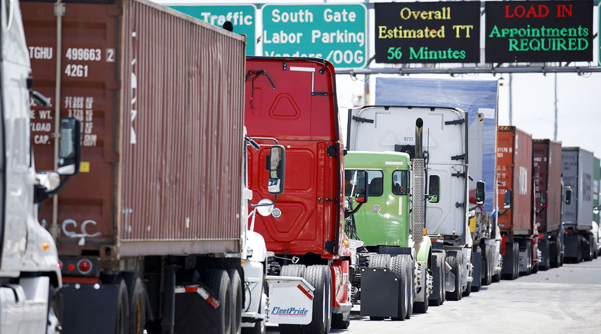 Trucks drive over border