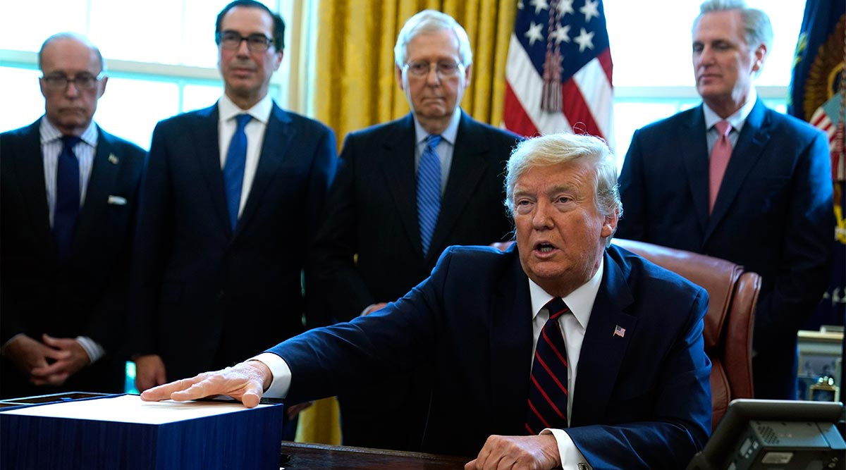 President Trump speaks to media in the Oval Office before signing $2.2 trillion stimulus package into law.