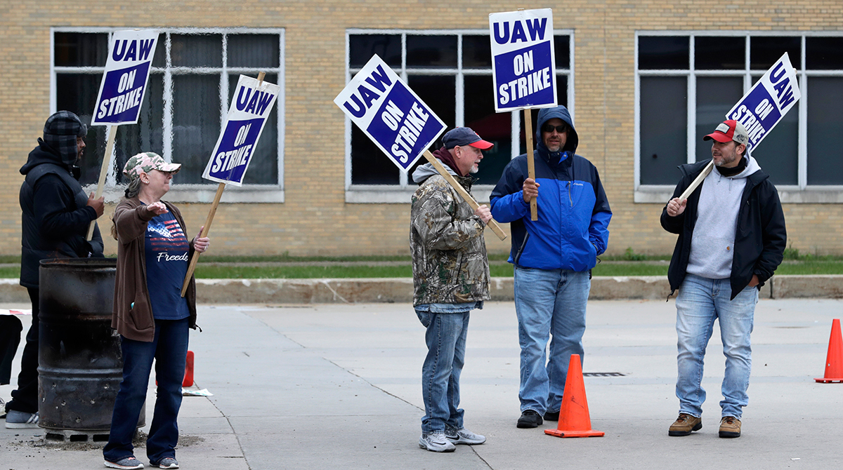 GM workers continue to strike.