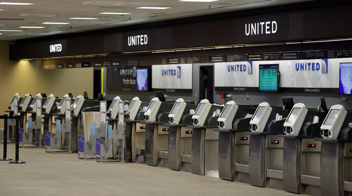 Empty United Airlines ticket machines are shown at the Tampa International Airport on April 24.