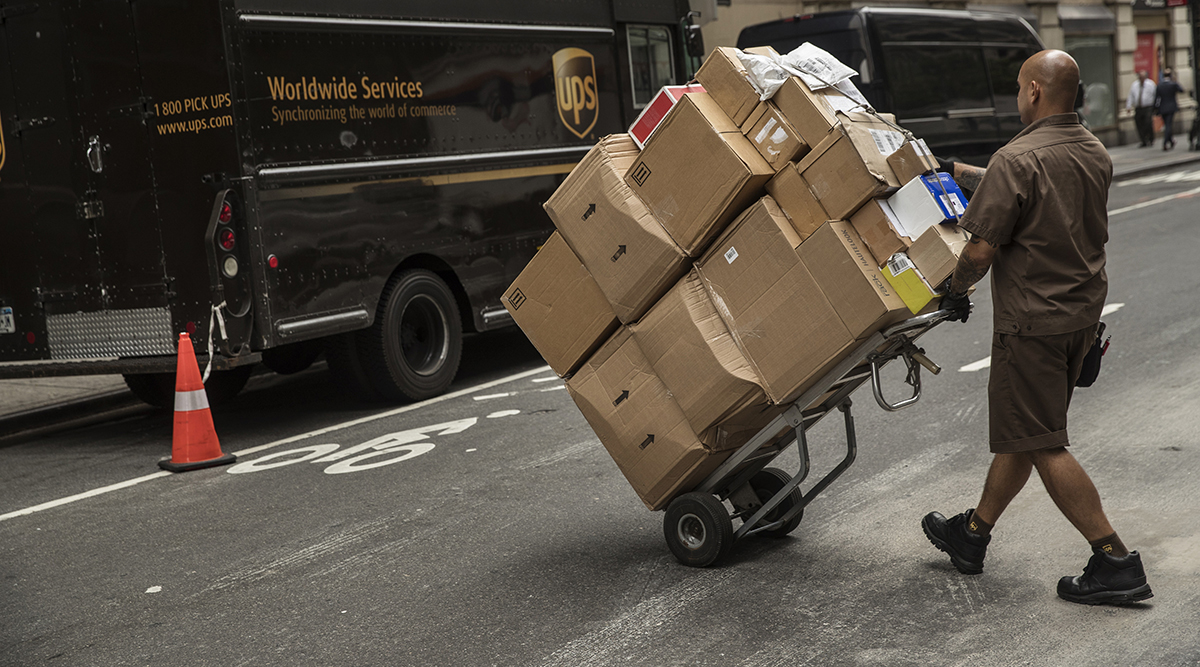 UPS employee delivers packages in New York City