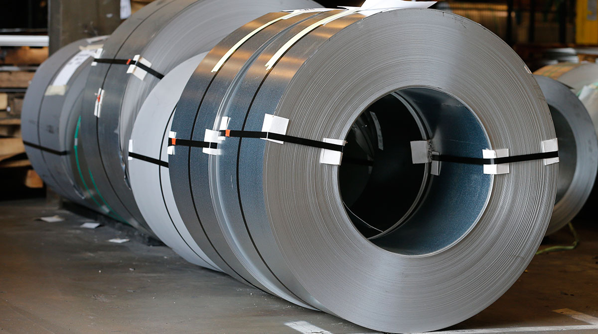 Rolls of steel sit in a warehouse at a fabrication company in Chester, Va.