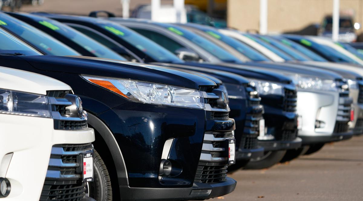 Used vehicles sit in a Colorado lot in November 2020. (David Zalubowski/Associated Press)