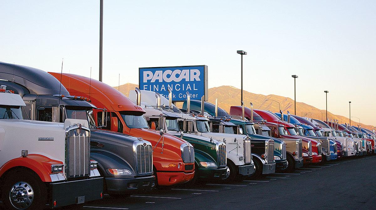 Used Kenworth and Peterbilt trucks on a sales lot