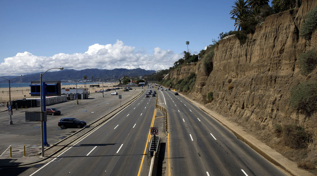 Vehicles drive in light traffic along Pacific Coast Highway in Santa Monica, Calif., on March 19.