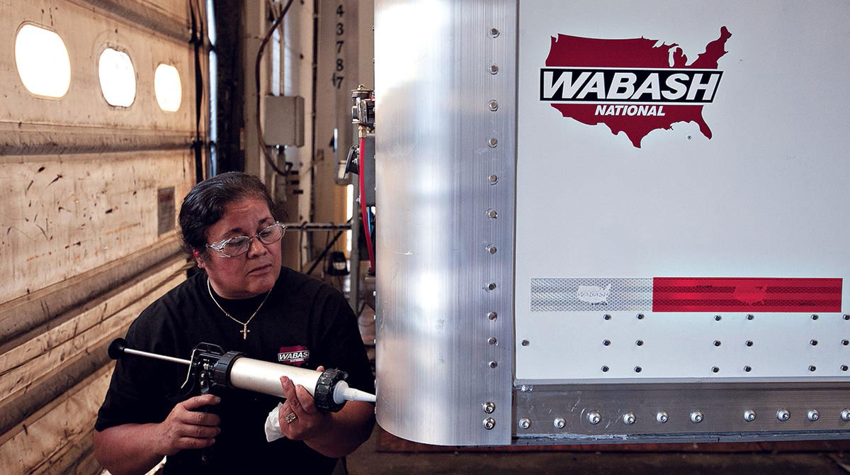 Wabash factory employee works on a trailer