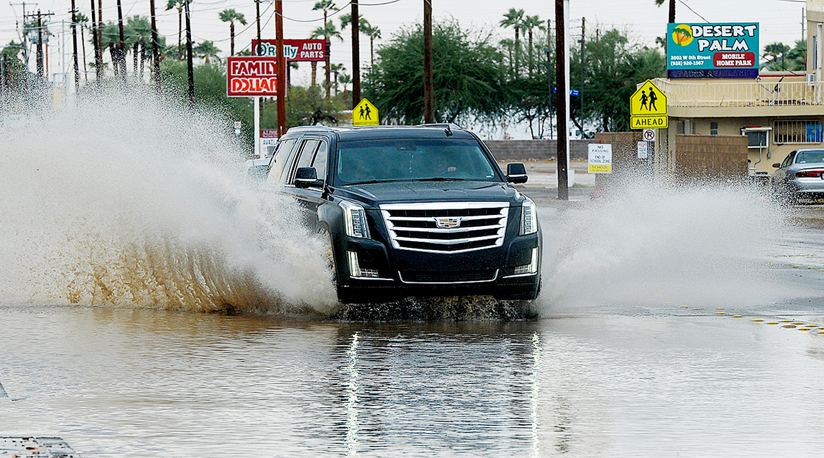 Car driving in flooded street