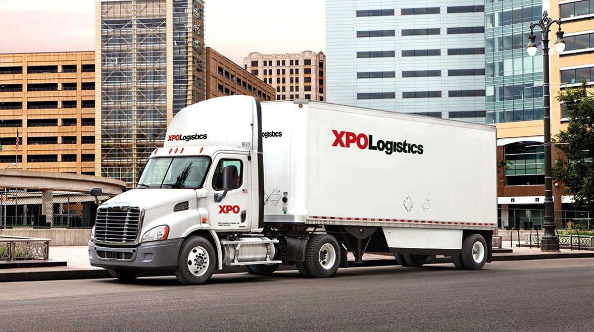 XPO Logistics truck on city street