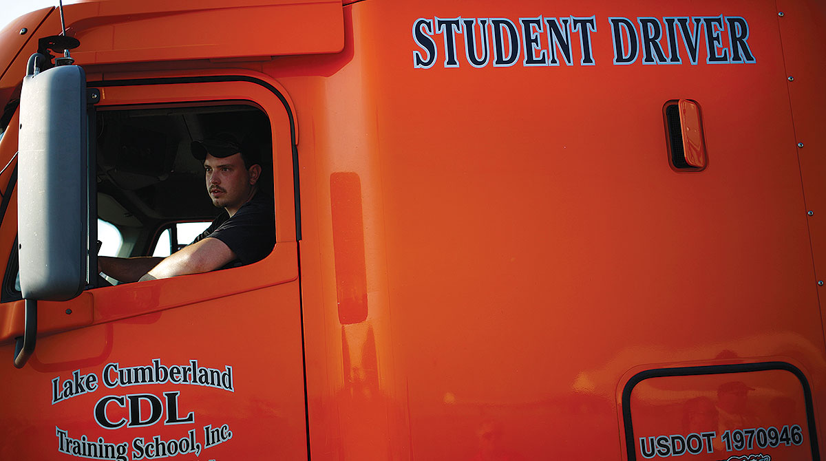 young driver behind the wheel