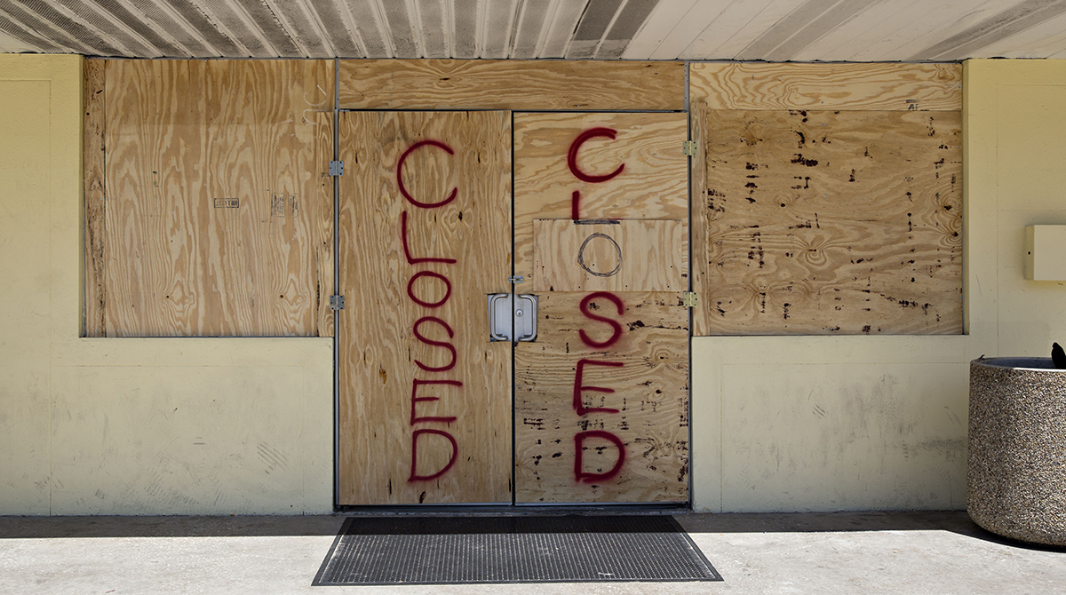 Plywood covers the doors of a 7-Eleven Inc. store ahead of Hurricane Irma in Madeira Beach, Fla.