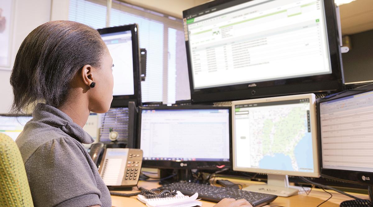 A worker uses fleet-management software