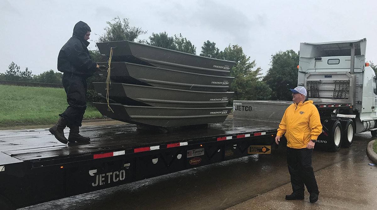 Jetco volunteers load canoes on flatbed truck