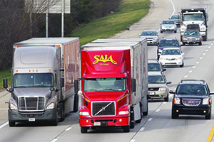Saia truck traveling on busy highway