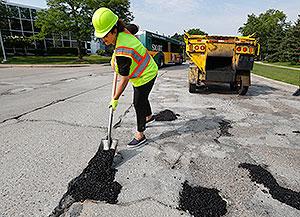 Gretchen Whitmer fills a pothole