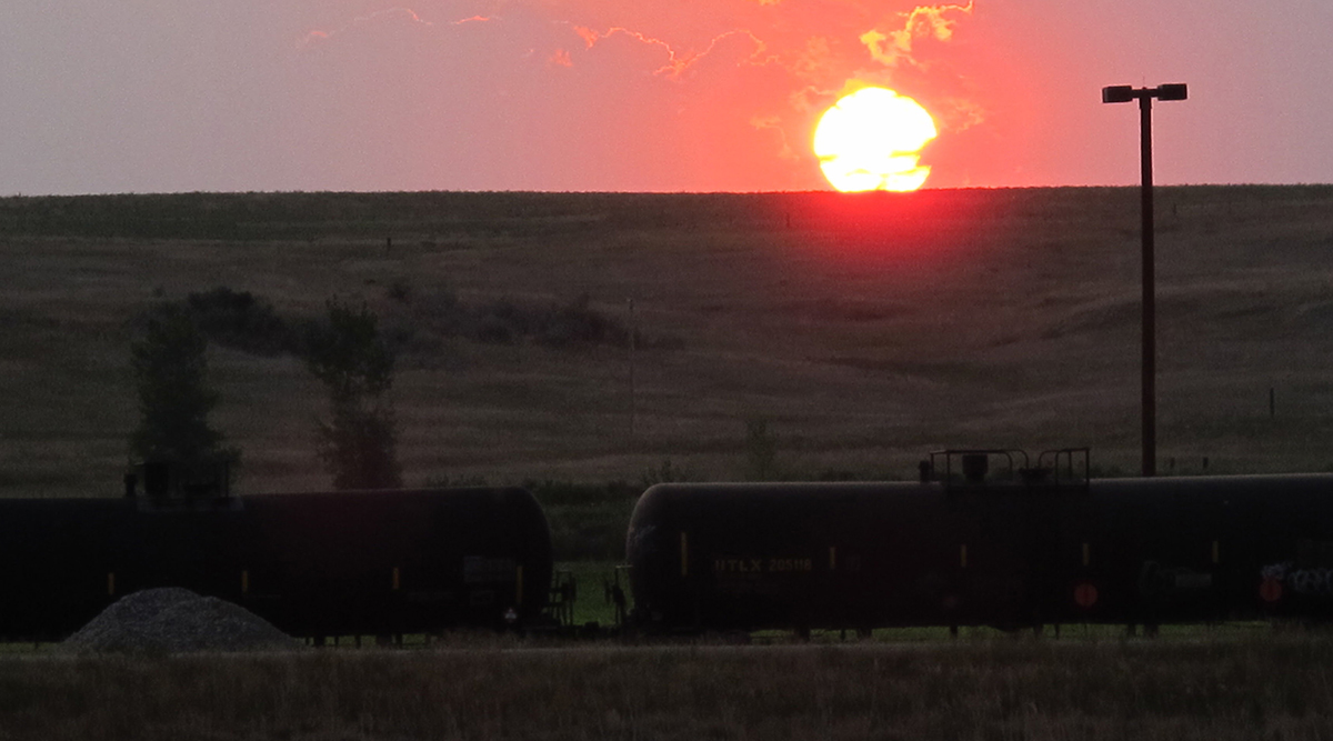 A freight trail full of tanker cars hauling crude oil crosses the plains near Trenton, N.D.