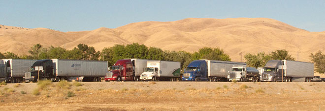 Trucks parked along Interstate 5 in California