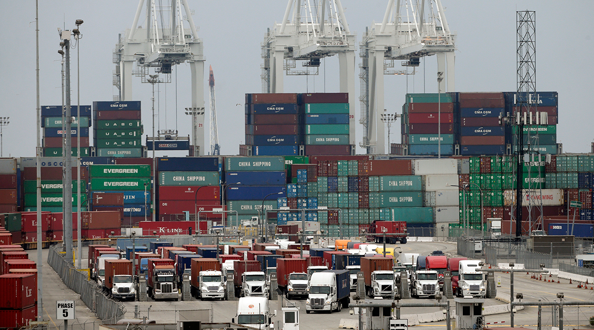 Cargo trucks wait in line at the Port of Long Beach, in Long Beach, Calif.;