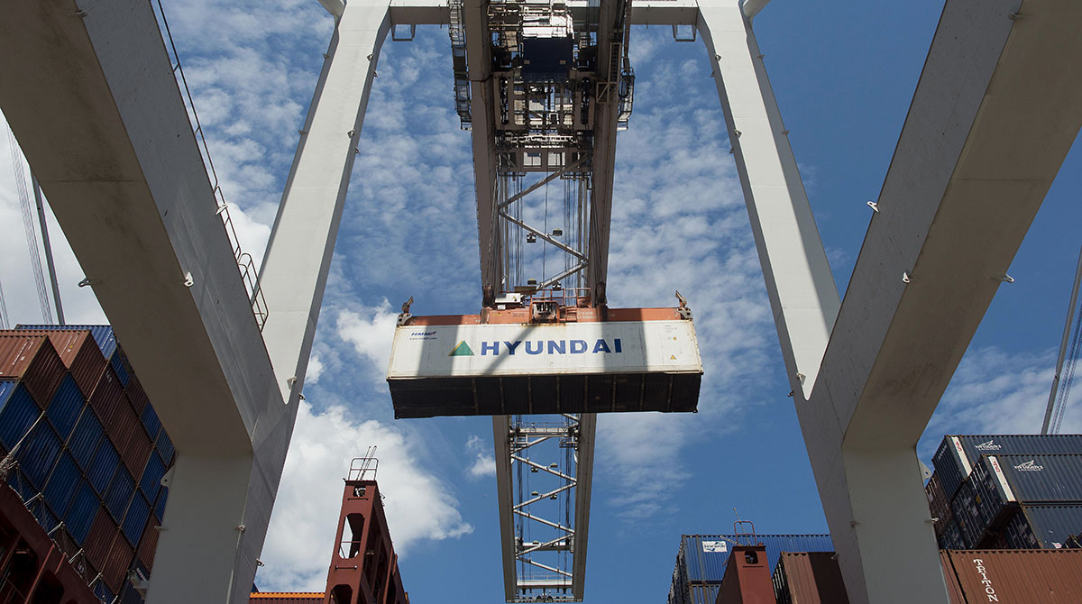 A container is loaded onto a ship at the Port of Savannah in Savannah, Ga.