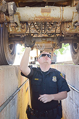 Officer inspecting a truck